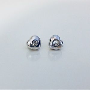 Heart shaped silver earrings with clear stone